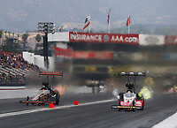 Feb 10, 2018; Pomona, CA, USA; NHRA top fuel driver Mike Salinas (left) races alongside Doug Kalitta during qualifying for the Winternationals at Auto Club Raceway at Pomona. Mandatory Credit: Mark J. Rebilas-USA TODAY Sports