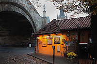 Cafe Marnice under an arch of the Charles Bridge or Karluv most, built 1357 - 15th century, in the Lesser quarter or Mala Strana, on the left bank of the Vltava river, Prague, Czech Republic. The historic centre of Prague was declared a UNESCO World Heritage Site in 1992. Picture by Manuel Cohen