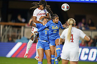 SAN JOSE, CA - DECEMBER 6: Madison Haley #3 of the Stanford Cardinal goes up for a header with Kaiya McCullough #5 and Viviana Villacorta #13 of the UCLA Bruins during a game between UCLA and Stanford Soccer W at Avaya Stadium on December 6, 2019 in San Jose, California.