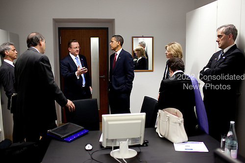 Dresden, Germany - June 5, 2009 -- Senior advisors brief United States President Barack Obama before a press conference with Chancellor Angela Merkel of Germany at Dresden Castle, Friday, June 5, 2009..Mandatory Credit: Pete Souza - White House via CNP