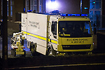 © Joel Goodman - 07973 332324 . No syndication permitted . 28/11/2013 . Manchester , UK . Army bomb disposal robot at the foot of the street . Scene at 17 Mellor Street in Eccles , Greater Manchester this evening (Thursday 28th November 2013) where police have cordoned off adjoining streets and evacuated houses following the discovery of a suspicious device .  Photo credit : Joel Goodman
