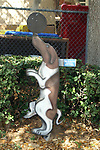 Free standing painting of Pebbles the dog in front of the elementary school in Lake Placid