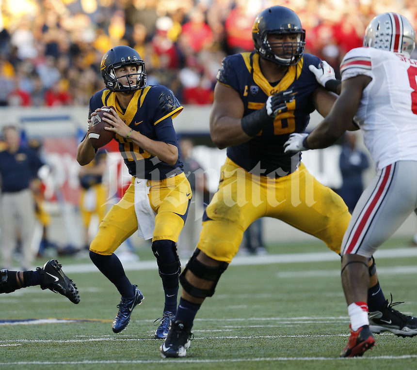California's Jared Goff (16) drops back to pass against Ohio State defense on the 1st quarter of their game in Memorial Stadium on September 14,  2013.  (Dispatch photo by Kyle Robertson)