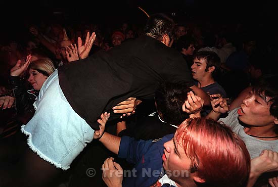 Second of three shots. Big girl stage dives at the Voodoo Glow Skulls concert.<br />
