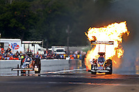 Aug. 18, 2013; Brainerd, MN, USA: NHRA top fuel dragster driver Spencer Massey (right) has a fireball alongside Brittany Force during the Lucas Oil Nationals at Brainerd International Raceway. Mandatory Credit: Mark J. Rebilas-