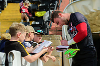 Lincoln City's Grant Smith signs an autographs for a fan during the pre-match warm-up<br /> <br /> Photographer Chris Vaughan/CameraSport<br /> <br /> The EFL Sky Bet League One - Lincoln City v Bristol Rovers - Saturday 14th September 2019 - Sincil Bank - Lincoln<br /> <br /> World Copyright © 2019 CameraSport. All rights reserved. 43 Linden Ave. Countesthorpe. Leicester. England. LE8 5PG - Tel: +44 (0) 116 277 4147 - admin@camerasport.com - www.camerasport.com
