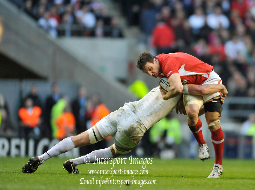 Twickenham, GREAT BRITAIN, Wales's Sam WARBURTON, tackled by Tom CROFT, during the 2012 Six Nations match, England vs Wales. Played at the RFU Stadium Twickenham, Surrey on Saturday  25/02/2012.  [Photo. Peter Spurrier/Intersport-images]