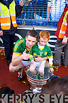 Marc O'Se and his nephew. Kerry players celebrate their victory over Donegal in the All Ireland Senior Football Final in Croke Park Dublin on Sunday 21st September 2014.