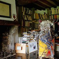 In the library a sculpture by French artist Cèsar Baldaccini stands amongst piles of books
