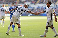 (L-R) Andre Ayew of Swansea City congratulates team mate Wayne Routledge during the Sky Bet Championship match between Swansea City and Cardiff City at the Liberty Stadium, Swansea, Wales, UK. Sunday 27 October 2019