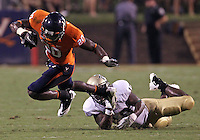 Sept. 3, 2011 - Charlottesville, Virginia - USA; Virginia Cavaliers wide receiver Tim Smith (20) gets tripped up by William & Mary Tribe linebacker Jabrel Mines (10) during an NCAA football game at Scott Stadium. Virginia won 40-3. (Credit Image: © Andrew Shurtleff