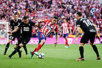 Angel Correa of Atletico de Madrid (R) in action against Gonzalo Escalante of SD Eibar (L) during the La Liga match between Atletico Madrid and Eibar at Wanda Metropolitano Stadium on May 20, 2018 in Madrid, Spain. Photo by Diego Souto / Power Sport Images
