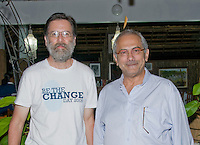 President Jose Ramos-Horta (right) welcomes American wildlife photographer Dan Suzio to Timor-Leste (East Timor) at his home in Dili on February 4, 2010. Photo by Claudia Abate / Dan Suzio Photography.