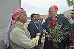 Cardinal Timothy Dolan, the archbishop of New York, greets Yazidi leaders as he arrives in Inishke, Iraq, on April 10, 2016. Dolan, chair of the Catholic Near East Welfare Association, is in Iraqi Kurdistan with other church leaders to visit with Christians and others displaced by ISIS. They celebrated Mass in the Chaldean Catholic church with local residents and displaced Christians living in local villages.<br /> <br /> CNEWA is a papal agency providing humanitarian and pastoral support to the church and people in the region.