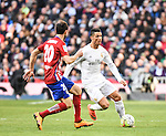 Real Madrid´s Cristiano Ronaldo and Atletico de Madrid´s Juanfran during 2015/16 La Liga match between Real Madrid and Atletico de Madrid at Santiago Bernabeu stadium in Madrid, Spain. February 27, 2016. (ALTERPHOTOS/Javier Comos)