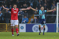Peter Murphy of Morecambe and Luke O'Nien of Wycombe Wanderers both appeal to the Assistant Referee during the Sky Bet League 2 match between Wycombe Wanderers and Morecambe at Adams Park, High Wycombe, England on 12 November 2016. Photo by David Horn.