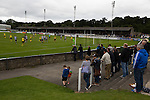 Home supporters watching the first-half action at Borough Briggs, home to Elgin City, on the day they played SPFL2 newcomers Edinburgh City (in yellow). Elgin City were a former Highland League club who were elected to the Scottish League in 2000, whereas Edinburgh City became the first club to gain promotion to the League by winning the Lowland League title and subsequent play-off matches in 2015-16. This match, Edinburgh City's first away Scottish League match since 1949, ended in a 3-0 defeat, watched by a crowd of 610.