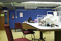 A social worker in the room next to where the HICAP classes take place at The Gen Chauncey M. Hooper Towers, that hosts the Harlem Internet Computer Access program taught by instructor Merle Bush in Harlem, Manhattan, NY, USA on November 16, 2011.