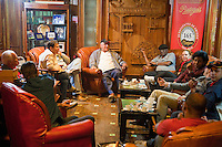 Cuba, Havana.  Partagas Cigar Factory.  Patrons Conversing in the Lounge.