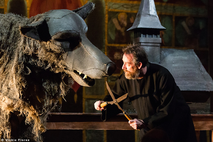 "Scene pictured: Father Nandru and grey wolf (with shears). Wilton's Music Hall presents ""Father Nandru and The Wolves"" by Julian Garner, a Romanian fantasy about a Transylvanian village performed with puppets that tell a gypsy tale about wolves and forests. Father Nandru and The Wolves is Wilton's last full scale production before the final stage of repair works begin to the main building at Wilton's, which is the oldest surviving grand music hall in the world."