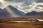 Isle of Skye, Scotland: Shaft of sun sweeps across Glamaig Mountain with the River Sligachan in the foreground.