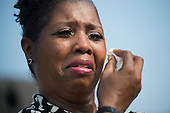 A woman becomes emotional during a remembrance ceremony for the 12th anniversary of the 9/11 terrorist attacks, at the Pentagon on September 11, 2013 in Arlington, Virginia. <br /> Credit: Kevin Dietsch / Pool via CNP