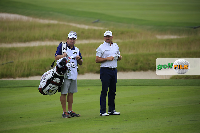 Graeme McDowell (NIR) and caddy Ken Comboy on the 3rd hole with the Church Pews in the background during Friday's Round 1 of the 2016 U.S. Open Championship held at Oakmont Country Club, Oakmont, Pittsburgh, Pennsylvania, United States of America. 17th June 2016.<br /> Picture: Eoin Clarke | Golffile<br /> <br /> <br /> All photos usage must carry mandatory copyright credit (&copy; Golffile | Eoin Clarke)
