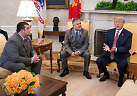 United States President Donald J. Trump meets with Shane Bouvet(left) and his father Don Bouvet(center) February 9, 2018 at The White House in Washington, DC. In 2017, Trump gave Bouvet $10,000 to pay for cancer treatments for his father. Credit: Chris Kleponis / CNP /MediaPunch