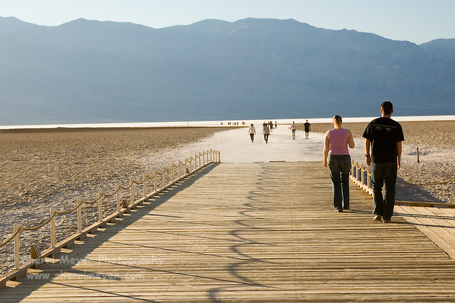 Visitors walking out on the playa at Badwater
