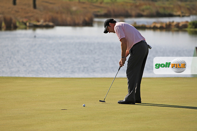 Jose Maria Olazabal (ESP) takes his putt on the 17th green during Thursday's Round 1 of the Portugal Masters at the Oceanico Victoria Golf Course, Vilamoura, Portugal 10th October 2012 (Photo Eoin Clarke/www.golffile.ie)
