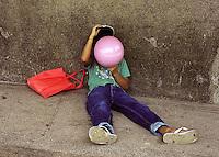 Boy kissing a balloon. Mankayan, Benguet. 17 September 2000