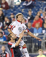 D.C. United midfielder Nick DeLeon (18) and New England Revolution defender A.J. Soares (5) battle for head ball.  In a Major League Soccer (MLS) match, the New England Revolution (blue) defeated D.C. United (white), 2-1, at Gillette Stadium on September 21, 2013.