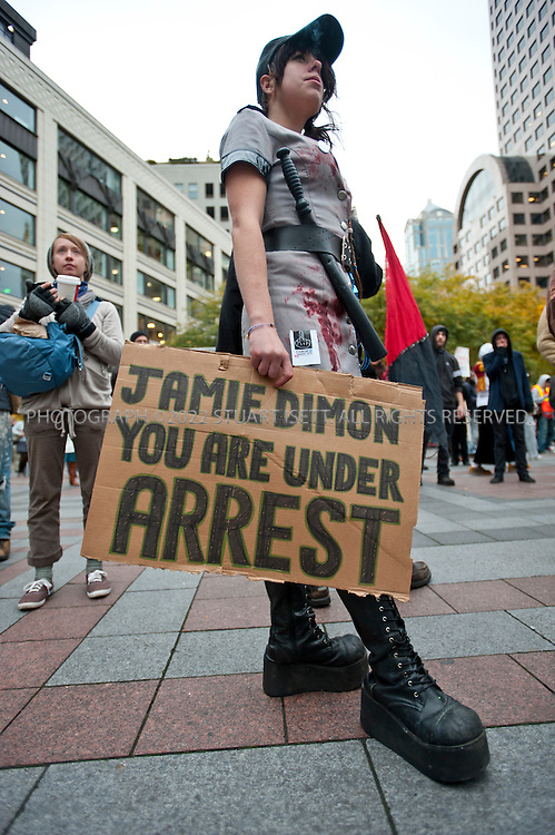 11/2/2011--Seattle, WASH., USA..Several hundred demonstrators from Occupy Seattle headed downtown and marched to the Sheraton Hotel where JPMorgan Chase CEO Jamie Dimon was invited to speak Wednesday night. Dimon was a speaker at a University of Washington Foster School of Business leadership celebration...Here protesters prepare for the march and rally at Westlake park...©2011 Stuart Isett. All rights reserved