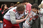 Travis Long signs autographs prior to the Crimson and Gray game, the culmination of the first spring session under new head coach Mike Leach at Washington State University, at Joe Albi stadium in Spokane, Washington, on Saturday, April 21, 2012.