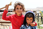 Bedouin Palestinian children play outside their makeshift tent in the Ein al-Uja village, close to the West Bank city of Jericho, April 27, 2019. Israeli bulldozers had demolished the village in several times, but villagers said that they insist on remaining in their village. Photo by Ayat Arqawy
