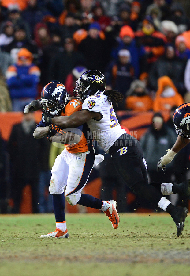 Jan 12, 2013; Denver, CO, USA; Baltimore Ravens linebacker Dannell Ellerbe (59) tackles Denver Broncos running back Ronnie Hillman (21) during the AFC divisional round playoff game at Sports Authority Field.  Mandatory Credit: Mark J. Rebilas-