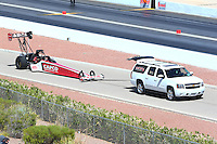 Mar 30, 2014; Las Vegas, NV, USA; NHRA top fuel driver Steve Torrence being towed down the return road during the Summitracing.com Nationals at The Strip at Las Vegas Motor Speedway. Mandatory Credit: Mark J. Rebilas-