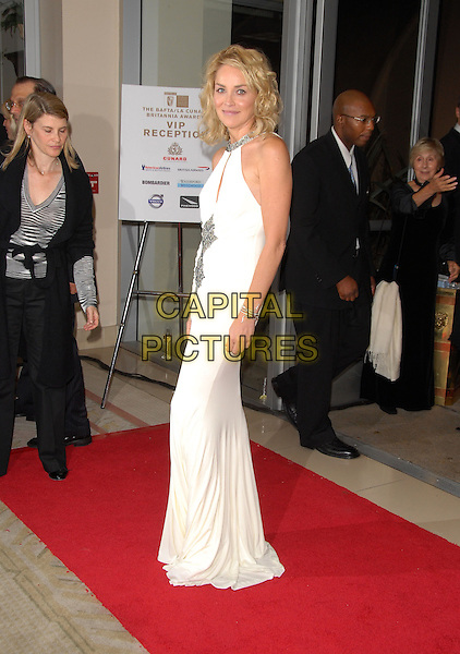 SHARON STONE.The 2006 BAFTA/LA Cunard Britannia Awards held at The Hyatt Regency Century Plaza in Century City, California, USA..November 2nd, 2006.Ref: DVS.full length white dress halterneck.www.capitalpictures.com.sales@capitalpictures.com.©Debbie VanStory/Capital Pictures