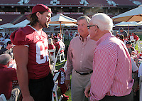 #82 Cobby Fleener talks Stanford University athletics director Bob Bowlsby, and a fan during the Stanford Football Kick Off Dinner at Stanford Stadium on Thursday, August 25, 2011. ( © Norbert von der Groeben )