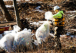 WATERBURY, CT-122117JS02---Workers from Clean Harbors, continue clean up along the Naugatuck River in Waterbury  on Thursday for the City of Waterbury. The clean up is one of the demands made by environmental officials as consequences for the October 9 spill of sewage into the river. <br /> Jim Shannon Republican-American