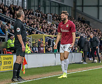 5th January 2020; Pirelli Stadium, Burton Upon Trent, Staffordshire, England; English FA Cup Football, Burton Albion versus Northampton Town; Jordan Turnbull of Northampton Town complaining to Assistant Referee Declan Ford after a decision goes against him - Strictly Editorial Use Only. No use with unauthorized audio, video, data, fixture lists, club/league logos or 'live' services. Online in-match use limited to 120 images, no video emulation. No use in betting, games or single club/league/player publications