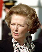 Prime Minister Margaret Thatcher of Great Britain, left, makes a statement following her 2 hour meeting with United States President Ronald Reagan (not pictured) outside the Diplomatic Entrance of the White House  in Washington, D.C. on Wednesday, February 20, 1985.  Mrs. Thatcher was in Washington for two days of talks with high administration officials.  Thatcher died from a stroke at 87 on Monday, April 8, 2013..Credit: Arnie Sachs / CNP