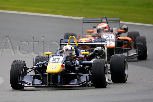 07.04.2012 Cheshire, England.  Spanish driver Carlos Sainz, Jr.in his Carlin Dallara Volkswagen and English driver Harry Tincknell in his Carlin Dallara Volkswagen in action during rounds 1, 2 & 3 of the Cooper Tires British Formula 3 International Series at Oulton Park.