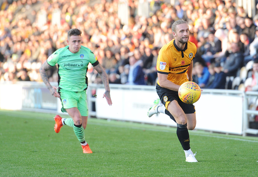 Newport County's Fraser Franks under pressure from Colchester United's Sammie Szmodics<br /> <br /> Photographer Kevin Barnes/CameraSport<br /> <br /> The EFL Sky Bet League Two - Newport County v Colchester United - Saturday 17th November 2018 - Rodney Parade - Newport<br /> <br /> World Copyright © 2018 CameraSport. All rights reserved. 43 Linden Ave. Countesthorpe. Leicester. England. LE8 5PG - Tel: +44 (0) 116 277 4147 - admin@camerasport.com - www.camerasport.com