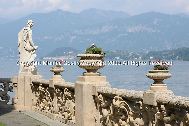 The gardens of Villa del Balbianello with a view of Bellagio in the background on Lake Como, Italy.