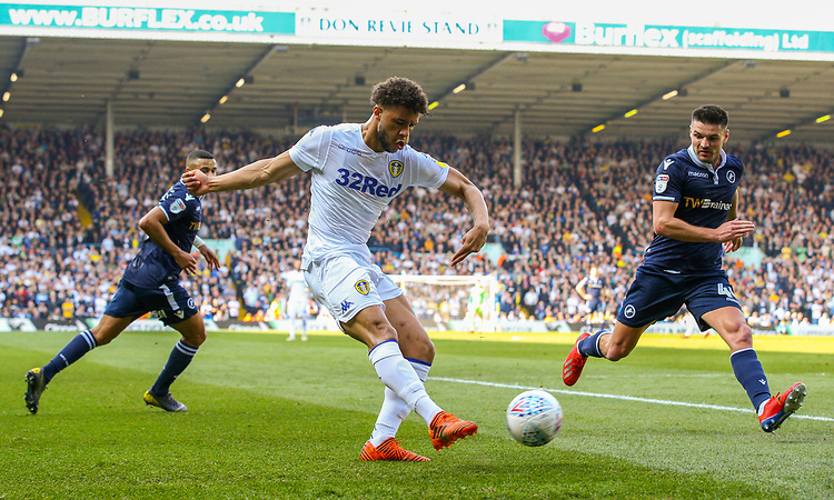 Leeds United's Tyler Roberts crosses under pressure from Millwall's Ben Marshall<br /> <br /> Photographer Alex Dodd/CameraSport<br /> <br /> The EFL Sky Bet Championship - Leeds United v Millwall - Saturday 30th March 2019 - Elland Road - Leeds<br /> <br /> World Copyright © 2019 CameraSport. All rights reserved. 43 Linden Ave. Countesthorpe. Leicester. England. LE8 5PG - Tel: +44 (0) 116 277 4147 - admin@camerasport.com - www.camerasport.com