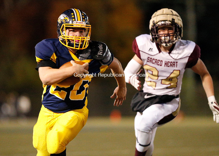 Waterbury, CT- 04 November 2016-110416CM14-  Kennedy's Jacob Colon carries the ball as Sacred Heart's Jovanni Celli gives chase during their NVL matchup in Waterbury on Friday.   Christopher Massa Republican-American