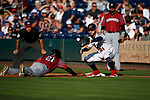 Sacramento River Cats' Mike Gerber dives back under the tag of Reno Aces' Wyatt Mathisen during a game in Reno, Nev., on Thursday, July 4, 2019.<br /> Photo by Cathleen Allison/Nevada Momentum