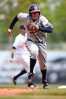 Mississippi Braves catcher Braeden Schlehuber (11) runs the bases during a game against the Montgomery Biscuits on April 22, 2014 at Riverwalk Stadium in Montgomery, Alabama.  Mississippi defeated Montgomery 6-2.  (Mike Janes/Four Seam Images)