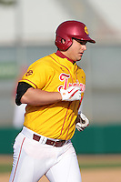 Brandon Garcia (14) of the USC Trojans runs the bases against the Jacksonville Dolphins at Dedeaux Field on February 19, 2012 in Los Angeles,California. USC defeated Jacksonville 4-3.(Larry Goren/Four Seam Images)